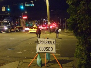 Pedestrians walking on closed crosswalk