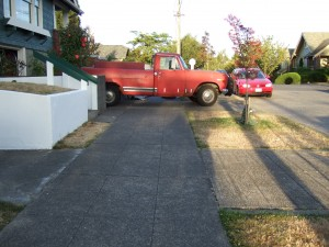 Red truck blocking sidewalk